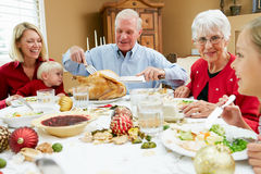 Multi Generation Family having Christmas Meal Stock Photography