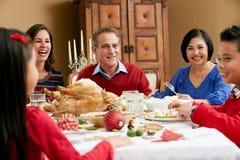 Multi Generation Family having Christmas Meal Stock Photo