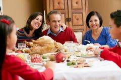 Multi Generation Family Having Christmas Meal Royalty Free Stock Photo