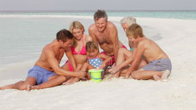 Multi Generation Family Having Fun On Beach Holiday Royalty Free Stock Images