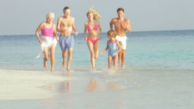 Multi Generation Family Having Fun In Sea On Beach Holiday Stock Photography