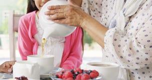 Multi-generation family having having tea 4k. Multi-generation family having having tea at home 4k stock video footage
