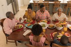 Multi-generation family having meal together on dining table royalty free stock photo