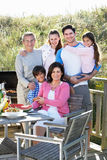 Multi Generation Family Having Outdoor Barbeque Royalty Free Stock Photography