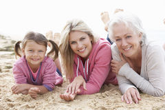 Multi Generation Family Lying On Beach Together Royalty Free Stock Photos