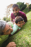 Multi generation family lying on grass at park Royalty Free Stock Image