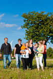 Multi-generation family on meadow in summer. Family and multi-generation - mother, father, children and grandmother having fun on meadow in summer Stock Photography