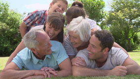 Multi Generation Family Piled Up In Garden Together stock footage