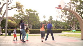 Multi Generation Family Playing Basketball In Slow Motion stock video