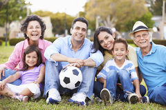 Multi Generation Family Playing Soccer Together Stock Image