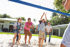 Multi Generation Family Playing Volleyball In Garden Royalty Free Stock Image