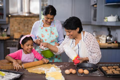 Multi-generation family preparing food together Stock Photo