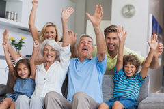 Multi-generation family raising their arms Stock Photography
