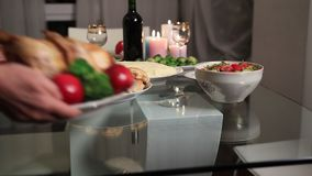 Multi generation family serving Thanksgiving table stock footage