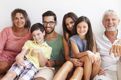 Multi Generation Family Sitting Against Wall Royalty Free Stock Photos