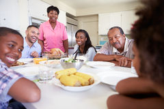 Free Multi-Generation Family Sitting Around Table Eating Meal Royalty Free Stock Images - 39236839
