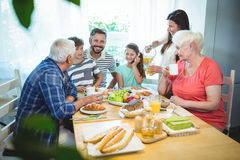 Multi-generation family sitting at breakfast table royalty free stock photography