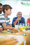 Multi-generation family sitting at breakfast table royalty free stock photos