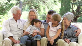 Multi Generation Family Sitting On Sofa At Home stock footage
