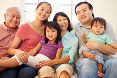 Multi Generation Family Sitting On Sofa At Home Together Stock Photography