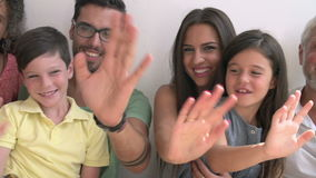 Multi Generation Family Standing Against Wall And Waving stock video footage