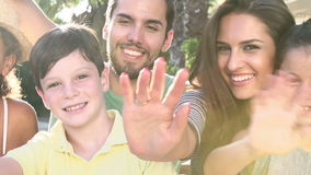Multi Generation Family Standing Outdoors And Waving stock video footage