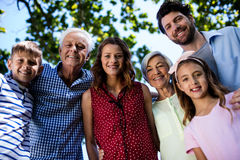 Multi generation family standing in park Royalty Free Stock Photos