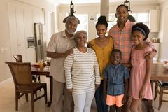 Multi-generation family standing together at home stock photos