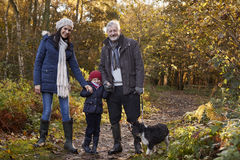 Multi Generation Family Take Dog For Walk In Fall Landscape Royalty Free Stock Photography