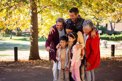 Multi-generation family taking selfie. Happy multi-generation family taking selfie at park Stock Images