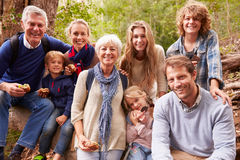 Multi-generation family with teens eating outdoors together stock photography