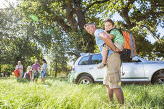 Multi-Generation Family Unpacking Car On Camping Trip Royalty Free Stock Photography