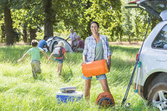 Multi-Generation Family Unpacking Car On Camping Trip Stock Photos