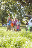 Multi-Generation Family Unpacking Car On Camping Trip Royalty Free Stock Images