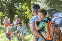 Multi-Generation Family Unpacking Car On Camping Trip Royalty Free Stock Image