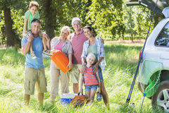 Multi-Generation Family Unpacking Car On Camping Trip Stock Photography