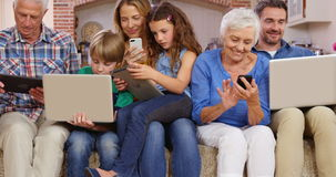 Multi generation family using devices stock footage