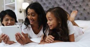 Multi-generation family using digital tablet in bedroom 4k. Multi-generation family using digital tablet in bedroom at home 4k stock video footage