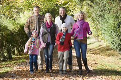 Multi-generation family on walk through woods Stock Images