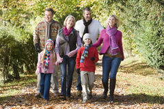 Multi-generation family on walk through woods Stock Image