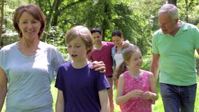 Multi-Generation Family Walking Along Woodland Path Together stock video