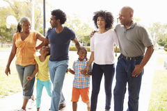 Multi Generation Family Walking In Park Together Stock Images