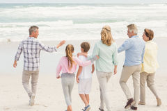 Multi generation family walking by the shore Royalty Free Stock Photos