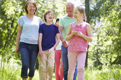Multi Generation Family Walking Through Summer Countryside Royalty Free Stock Photo