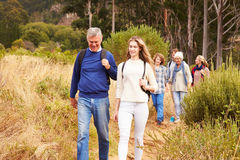 Multi-generation family walking together through a forest Royalty Free Stock Photography