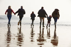 Multi Generation Family Walking On Winter Beach Royalty Free Stock Photography