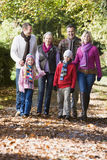 Multi-generation family walking through woods Stock Image