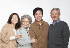 Multi generation happy family portrait, studio shot Royalty Free Stock Photo