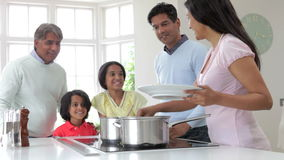 Multi Generation Indian Family Cooking Meal At Home Royalty Free Stock Image