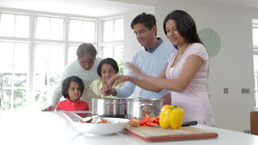 Multi Generation Indian Family Cooking Meal At Home Royalty Free Stock Photography